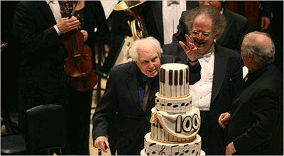 From right, Daniel Barenboim and James Levine onstage at Carnegie Hall to help Elliott Carter celebrate his birthday