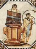The water organ (or hydraulis). Note the presence of the curved trumpet, called the bukanē by the Greeks and, later, cornu by the Romans.Hydraulis_001
