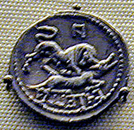 bull of Italy trampling wolf of Rome; inscription is in Oscan