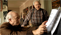 Elliott Carter, right, and Charles Rosen at Mr. Carter's apartment in New York. Copyright The New York Times.